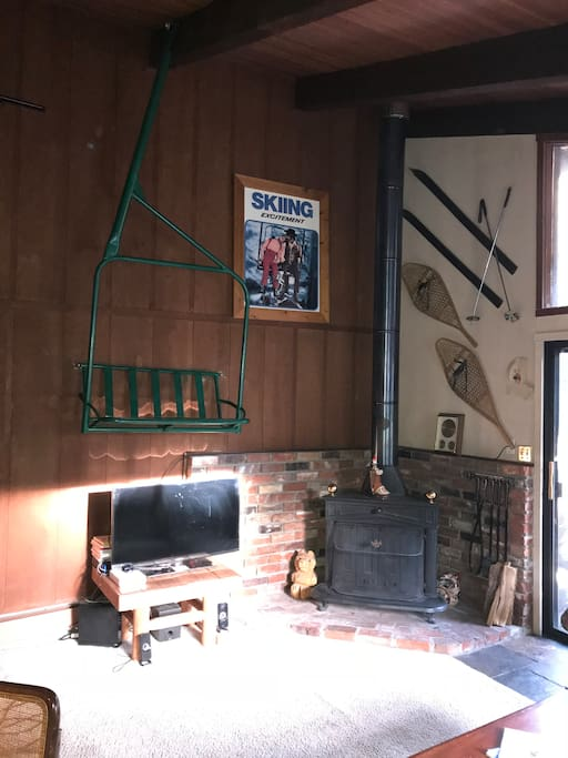 Fireplace, TV and ski chair in living room