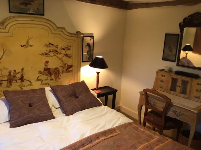 Double bed in Chinese decorations. Small room.