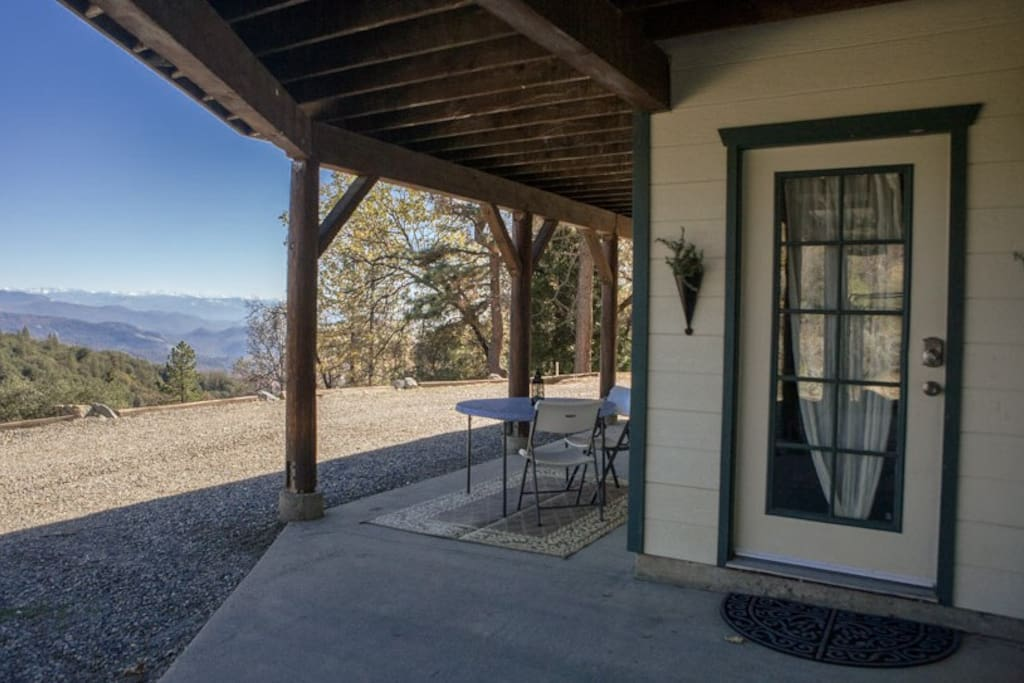 Private Entrance. Outdoor patio with chairs and table to take in the views! Many guest enjoy their morning coffee here :)