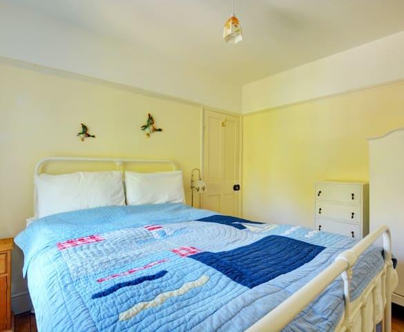 Bedroom 2: First floor bedroom with double bed.