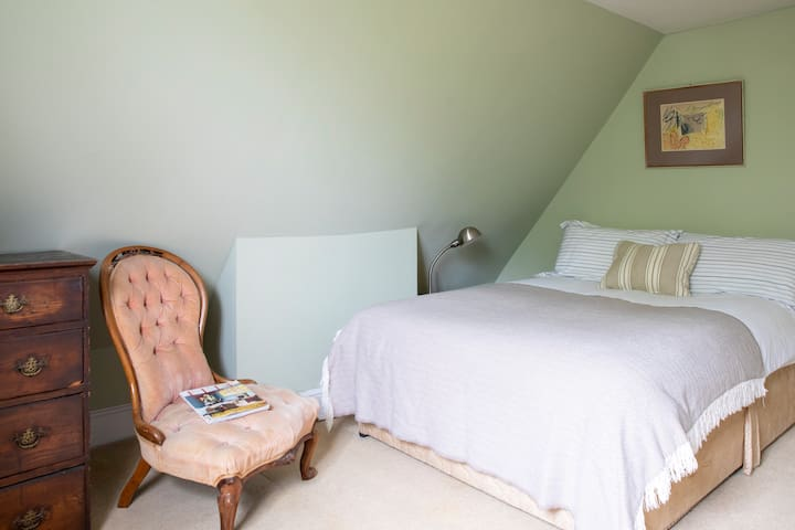 Plenty of room in the attic with double bed, single bed and attached en suite