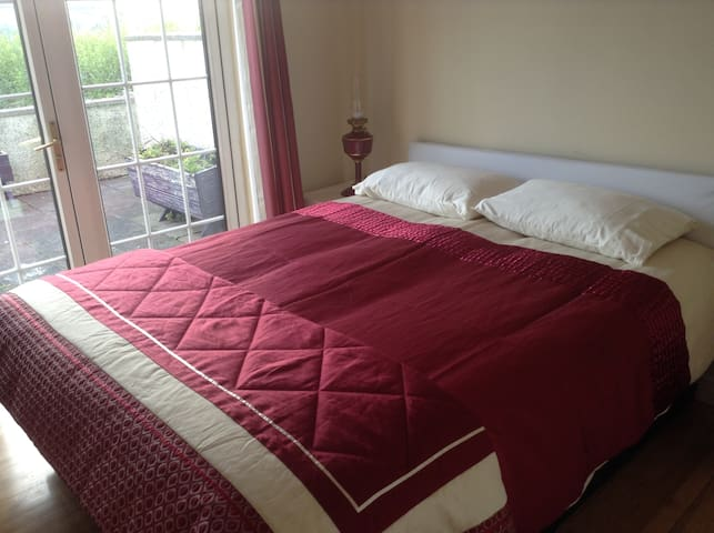Beautiful King bed, ground floor, bathroom beside.