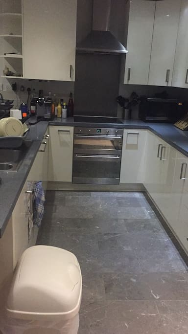 Kitchen with dishwasher, induction hob and double oven