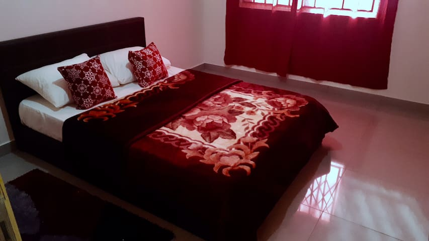 First Bedroom with Queen Size Bed