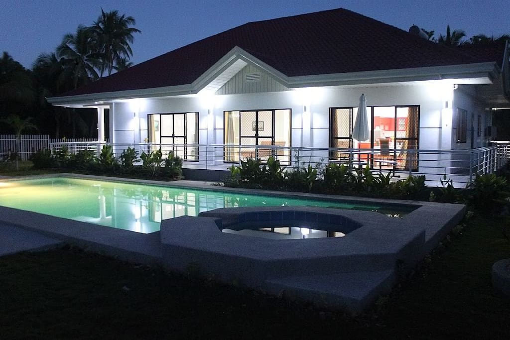 Night view of the pool and the house.