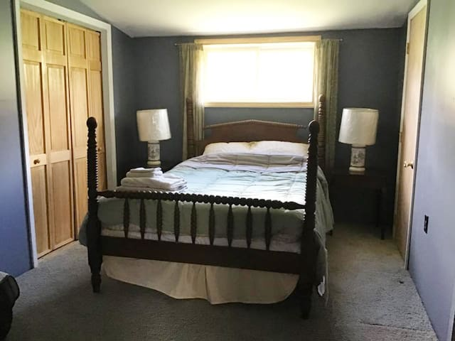Bedroom #2 - The Blue Dun Bedroom. Charming, comfy double with double window looking out to Stardust Meadows, two closets. Portable AC unit available if needed. **UPDATED SPRING 2019**