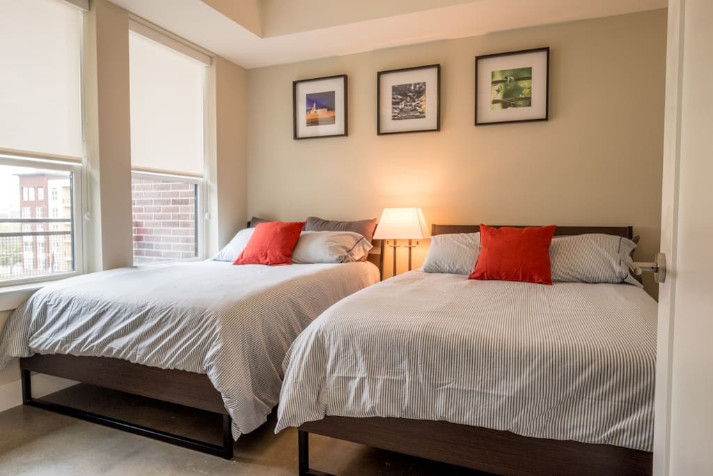 The second bedroom comes with two full beds, ideal for two friends or up to two couples.