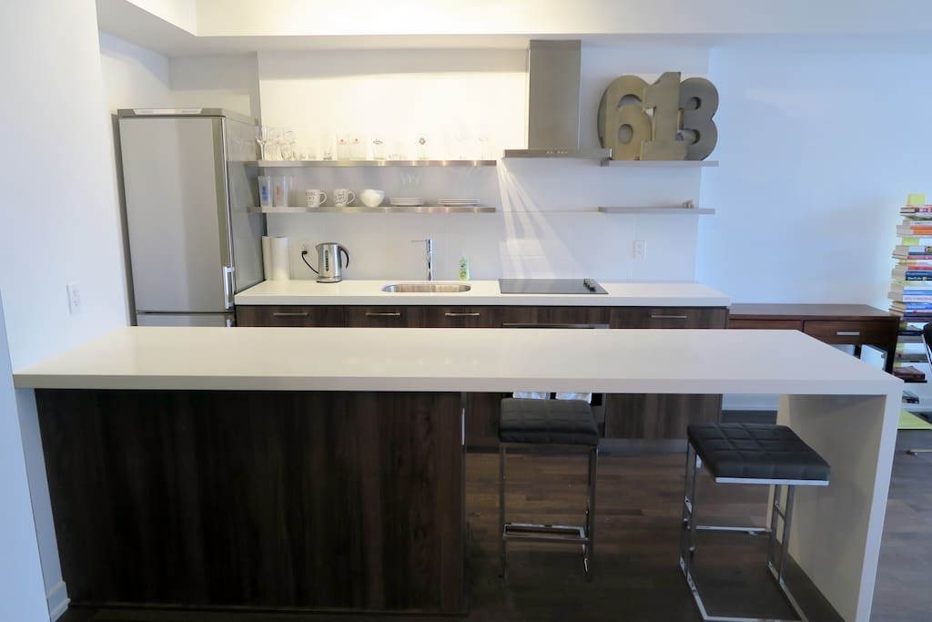 Modern kitchen & bar with 2 stools
