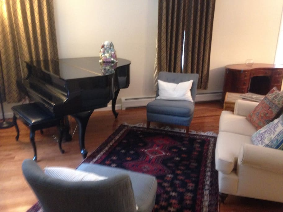 Come in and make yourself at home. The open floor plan of the first floor is perfect for gathering with friends. All the better if someone has musical talent to take advantage of the baby grand!