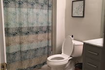 Bathroom - curtain rod is curved out to provide additional room.