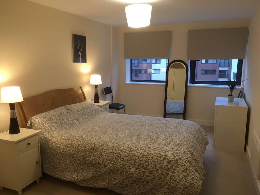 Large double bedroom with plenty of storage