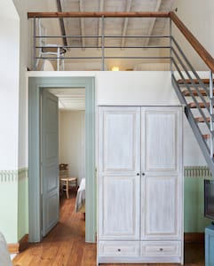 Metal and wooden staircase leading to the twin mezzanine bedroom