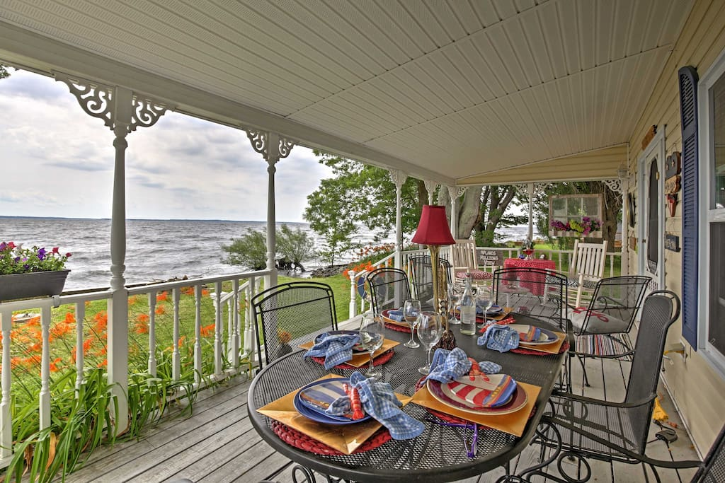 Relax on the covered front porch and take in the stunning views of Lake Ontario.