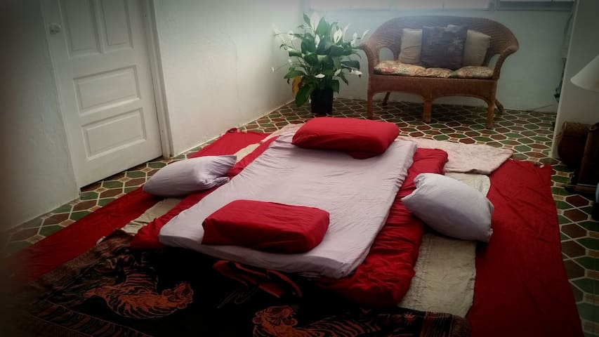 Living room set up for a Thai Massage session