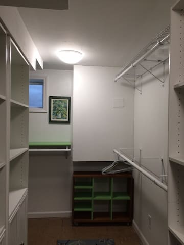 Walk in closet and dressing room with cedar storage in Back Gate suite.