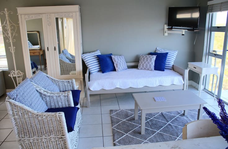 Lounge area with single bed also serving as a couch