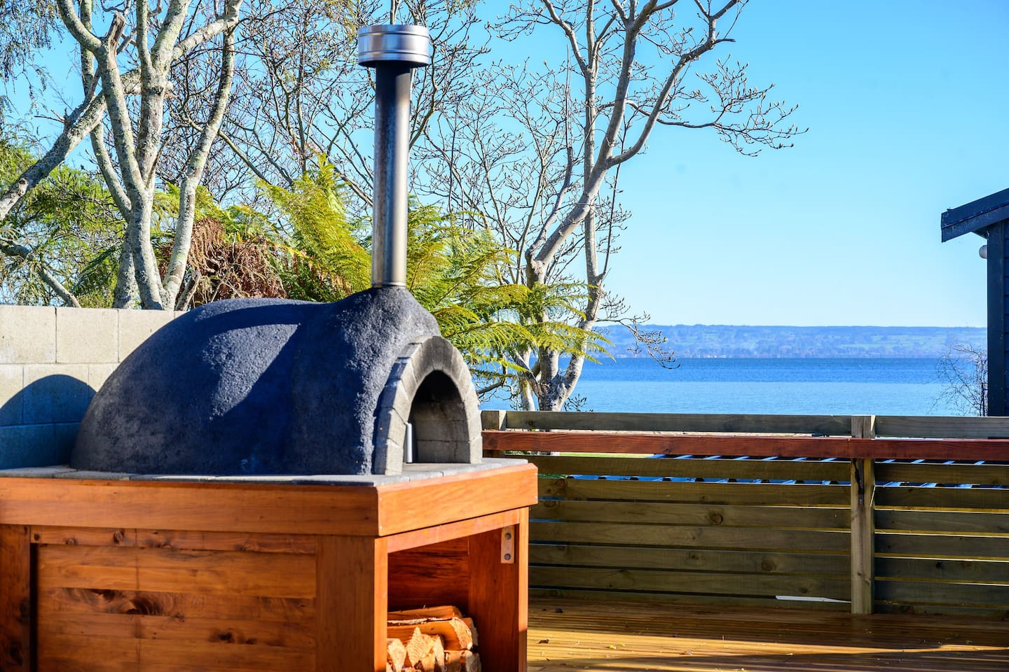 Best airbnbs in Rotorua for families featured by top family travel blogger, Marcie in Mommyland: lake view from the deck