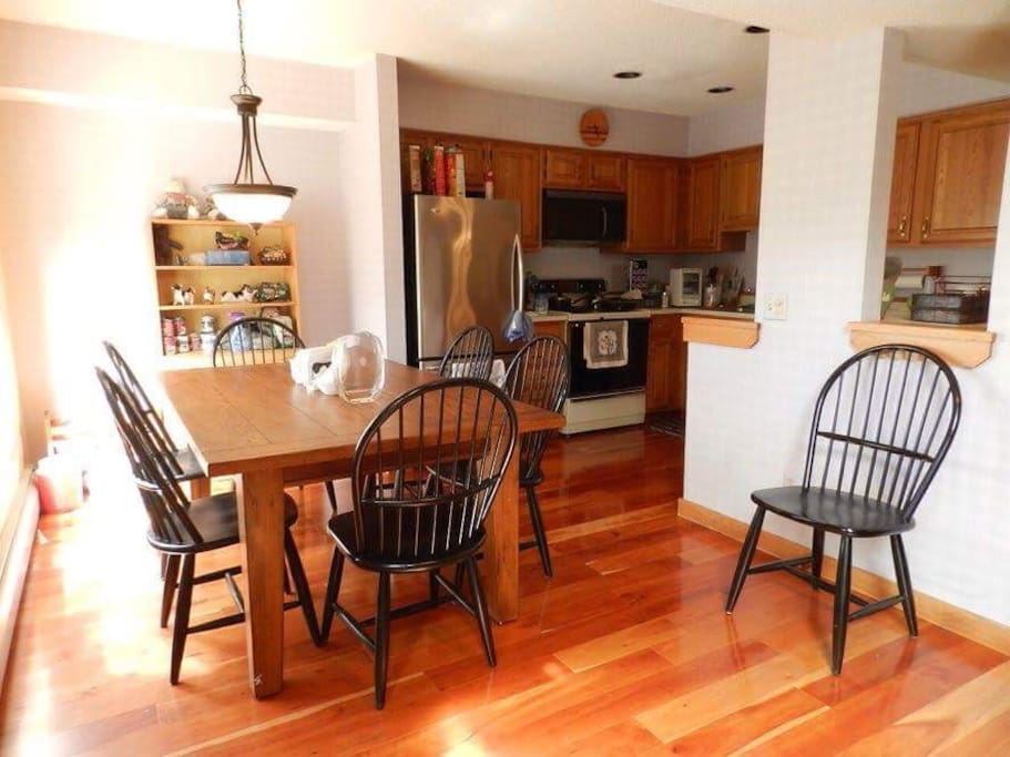 New Dining Room Table and chairs all solid wood floors on two floors and stairs new stainless steal appliances in Kitchen with K Cup
