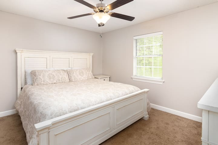 Spacious bedroom with comfortable king size bed and flat screen TV.  Each bedroom has it's own private bathroom and walk-in closet.