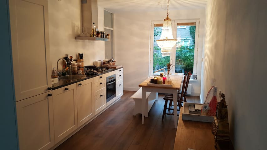 The Kitchen with an entrance to a small garden