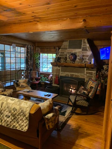 The cozy living room has a fire place you can enjoy while there is plenty of natural light coming through the windows. We offer roku on the tv, wifi, and a phone for local calls.