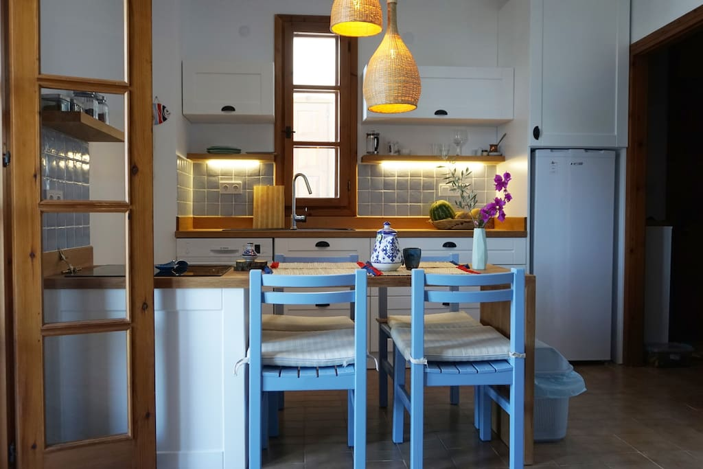 Renovated white bright kitchen. fully equipped to cook home.
