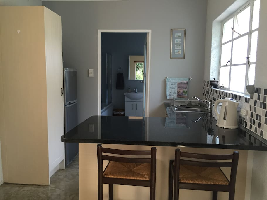 Neat and fully equipped kitchen with a spacious working station.