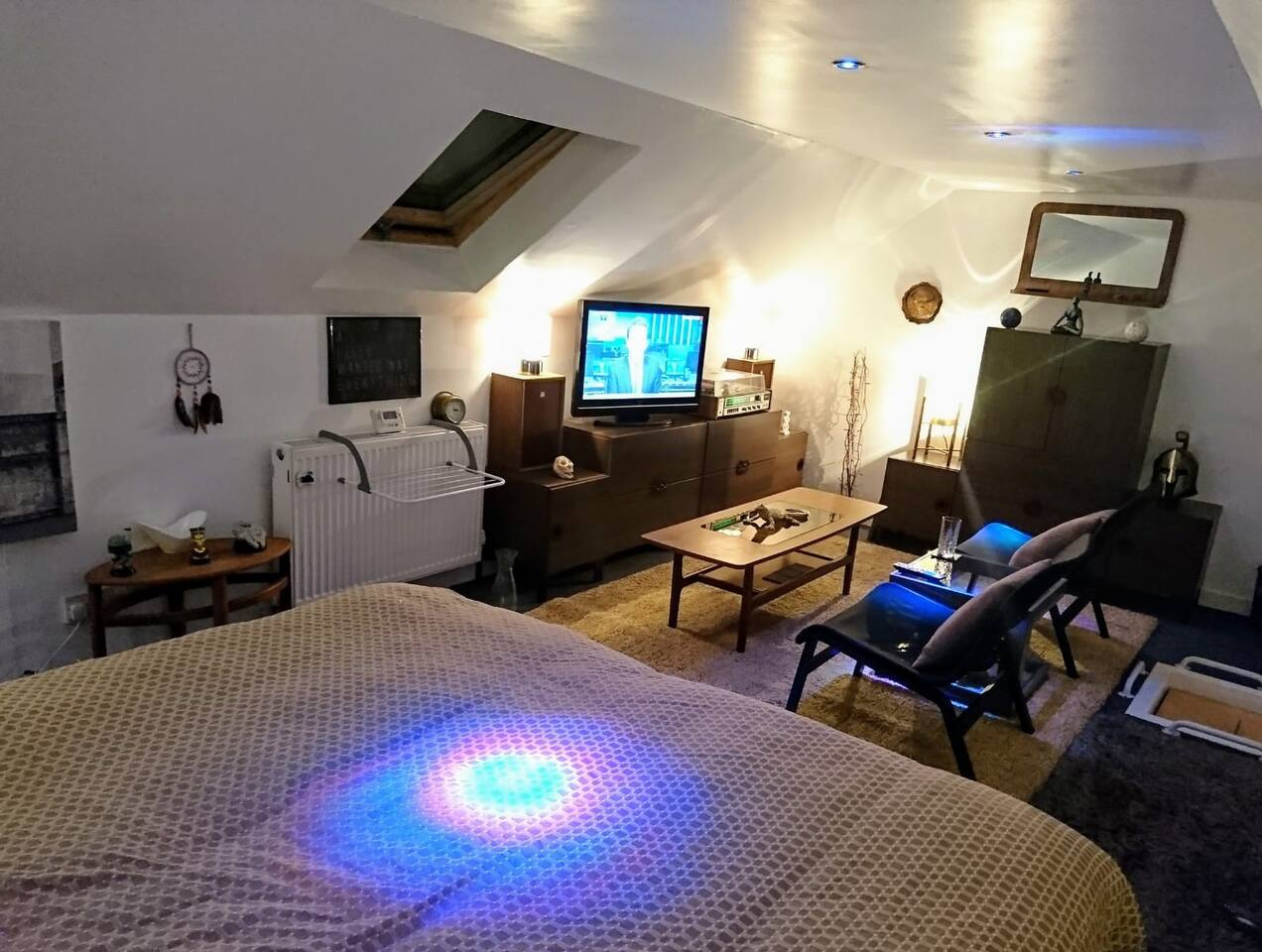 PLEASE NOTE THIS ROOM IS IN THE ATTIC AND ACCESS IS VIA A LADDER - photos  Fantastic open plan loft space with twin or double bed, with separate seating area with smart tv , sound bar, tea and coffee making facilities.