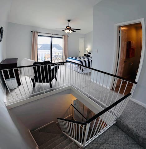 The relaxing third floor master has a full bath with stand up shower, and a large balcony with chairs and a table looking towards the ocean front.