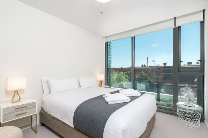 The bedroom is beautifully presented. It is fitted with a comfortable queen-sized bed topped with premium, hotel-style linens.