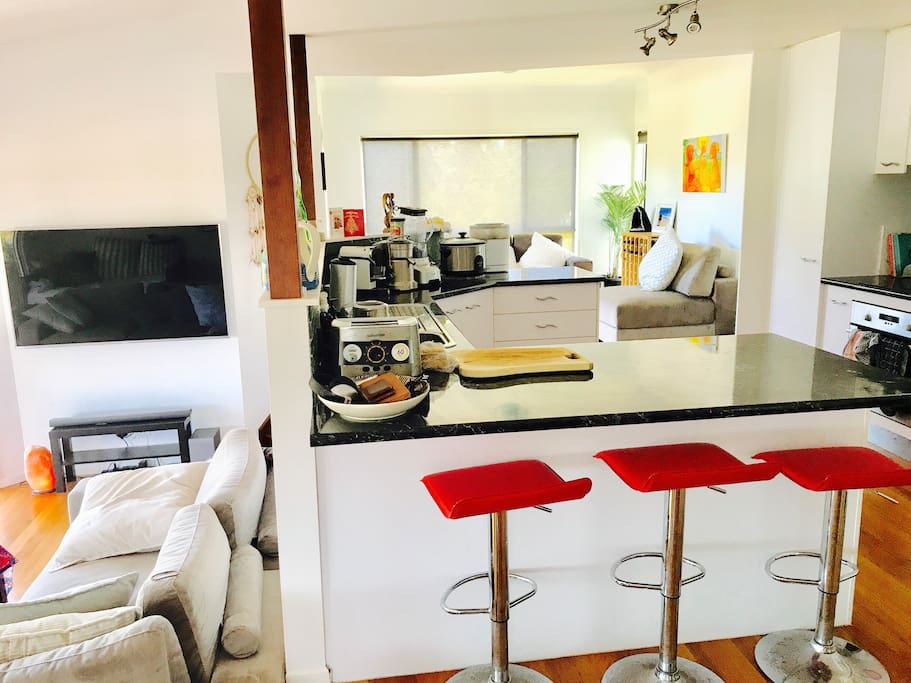 Lounge, kitchen and dining areas. Additional lounge behind the kitchen and indoor dining table with high chair available.