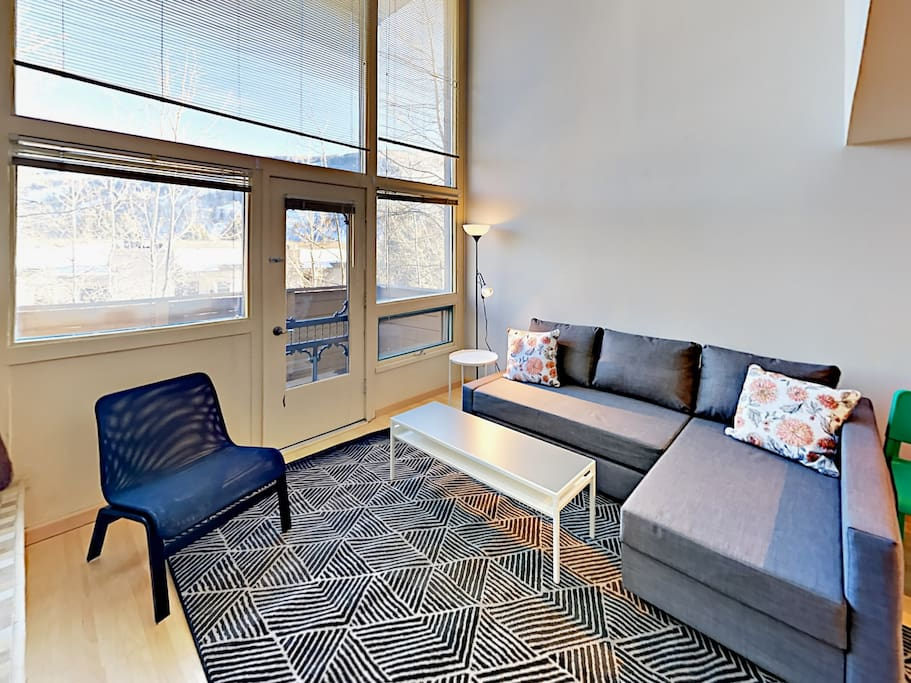 The living room is the perfect spot for relaxing after a day of skiing. The home is professionally cleaned by TurnKey's dedicated housekeeping team.