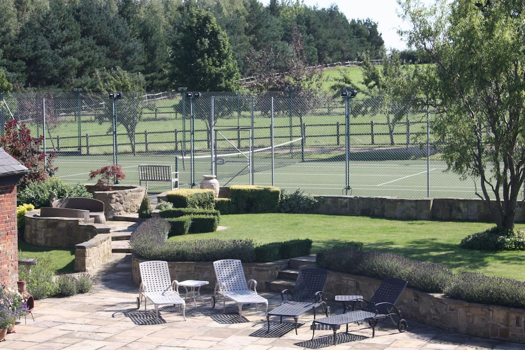 Extensive gardens with floodlit tennis court