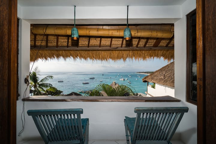 Wake up in the huge king size bed to this view each morning. Check the surf before heading out or relax with a drink at sunset. All from your private balcony