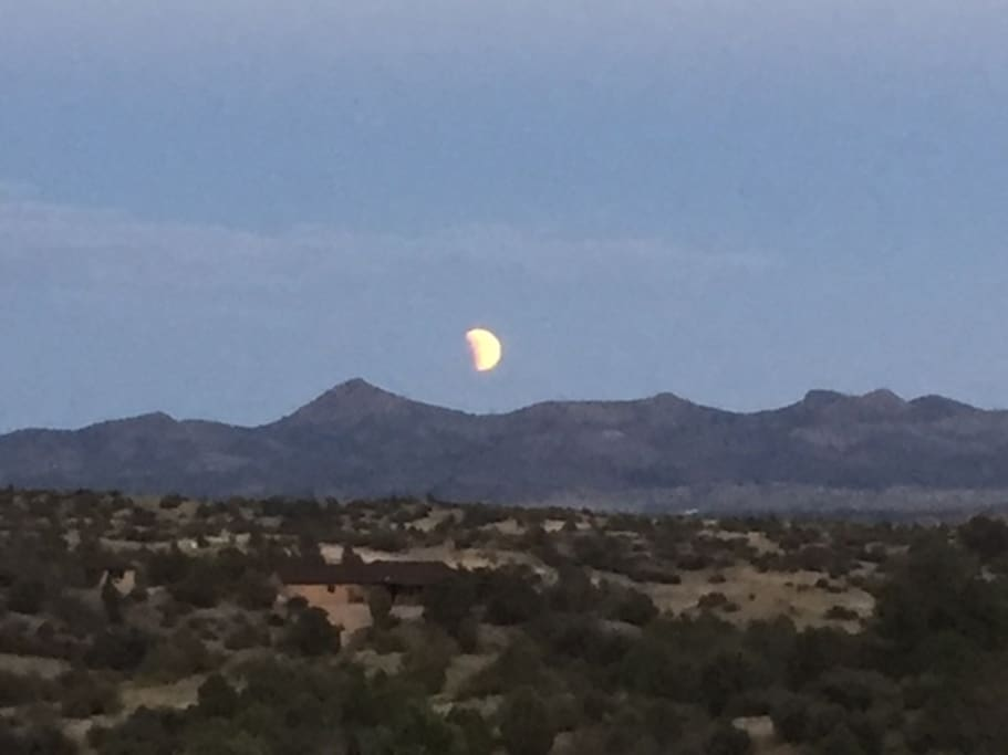 View from the cottage of the moon over Sullivan Butte