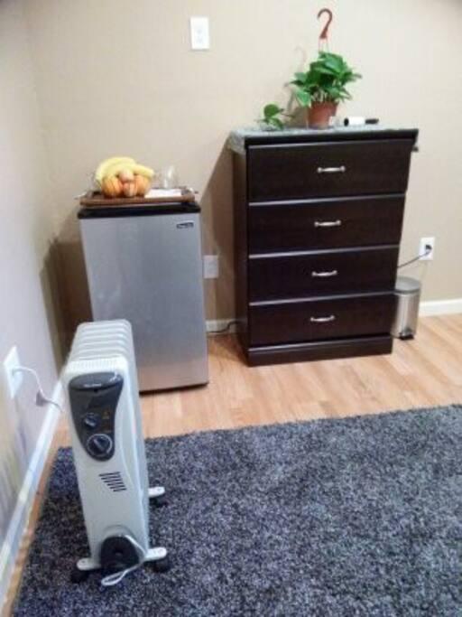 Small refrigerator and dresser.