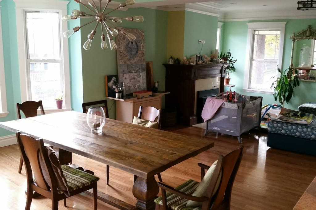 Spacious, open plan living room/dining room with gas fireplace and hardwood floors