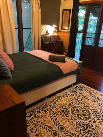 Main bedroom; access to verandah