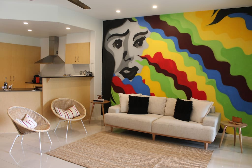 This lounge is the 'talk of the town!' Look at this mural painted on the wall free-hand!