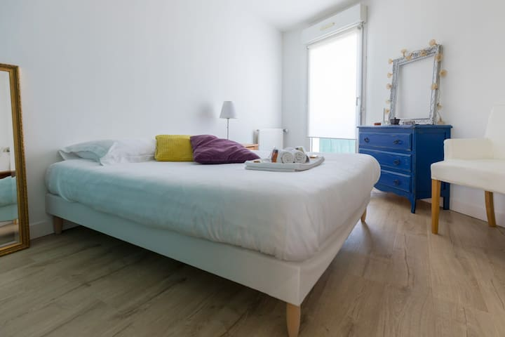 Double bed in the bright bedroom
