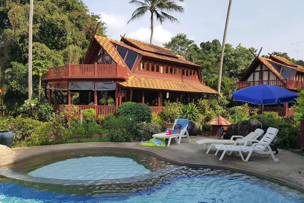 Teak-wood villa just moments from the beach and pool....