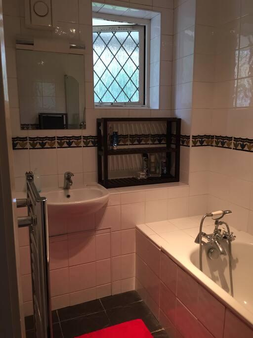 Bathroom with shower and bathtub.