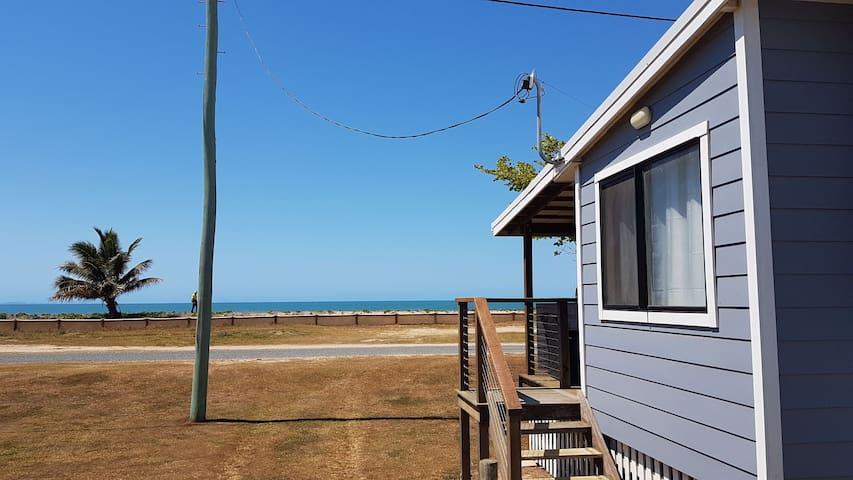 Sea Breeze - Beach front cottage.