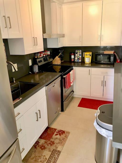 Kitchen with all appliances, Keurig, dishwasher, fridge, dishes, condiments, etc.