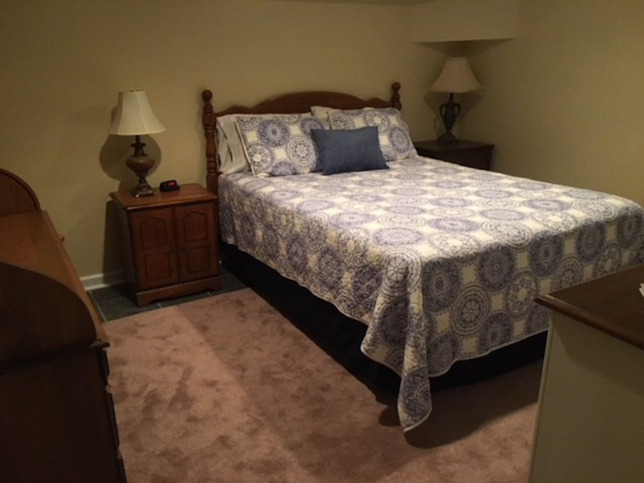 The queen bed in Suite 5.