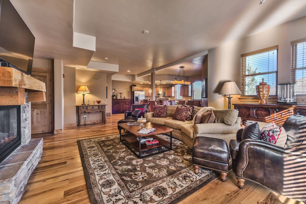 Great Room with Living Room, Dining Area and Kitchen with Beautiful Hardwood Floors Throughout