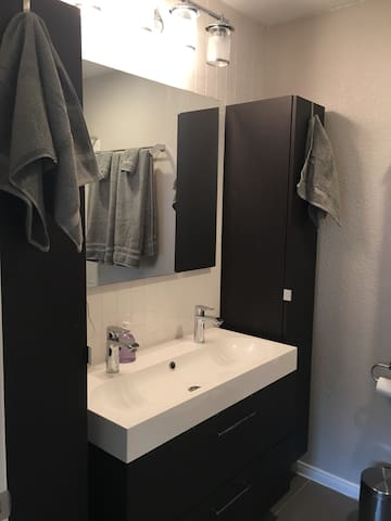 Upstairs bathroom was recently remodeled and features 2 faucets