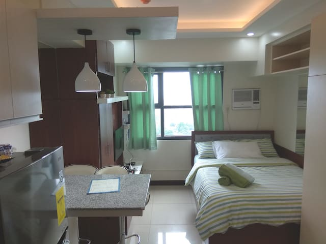 *Your Home Away*  @ Horizons 101 condominium.