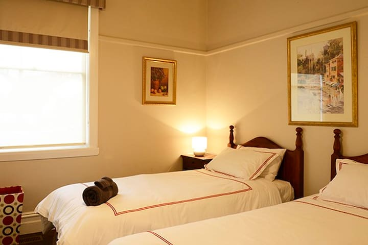 The third bedroom has two long single beds