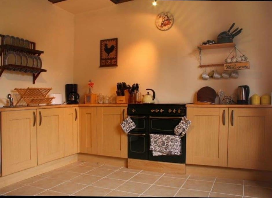 Full kitchen with large oven and fridge